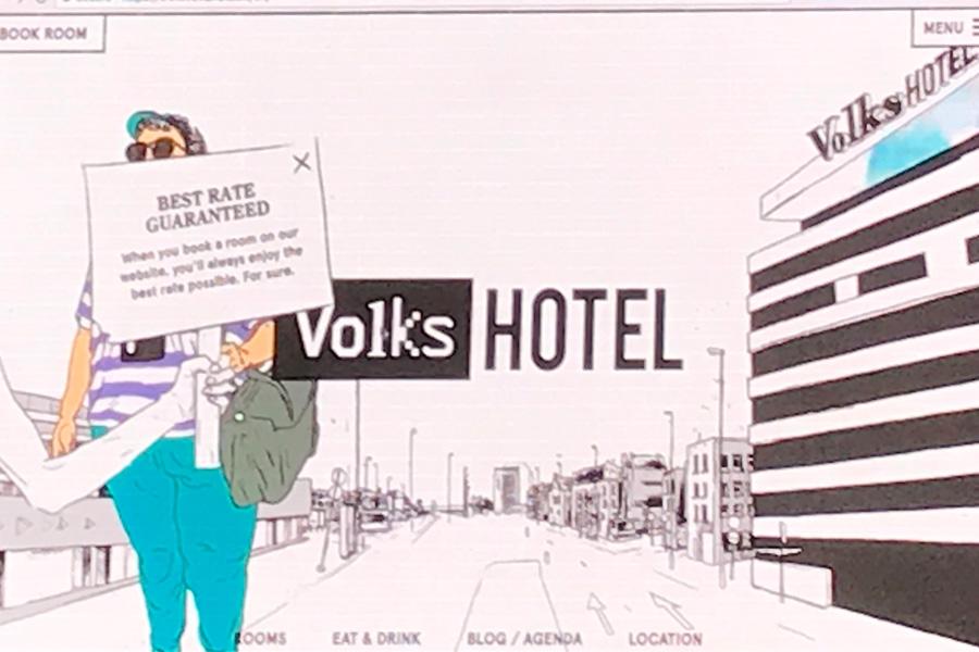 Volks hotel s interaktivním popupem ruky